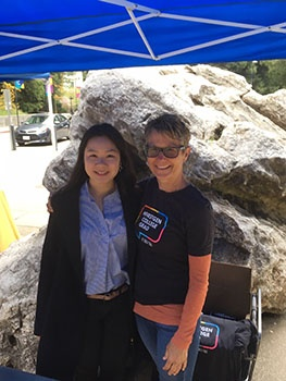 In Quarry Plaza, Gwynn Benner, assistant vice provost for UC Santa Cruz's Division of Student Success, and Christina Yu (College Ten '20, cognitive science), were at a table in the courtyard, getting the word out about the campus's First-Generation Initiative.