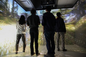 The CAVE combines high-resolution, stereoscopic projection and 3-D computer graphics to create a complete sense of presence in a virtual environment, with projections covering three walls and the floor.
