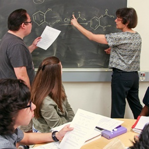 ACE Program director Nancy Cox-Konopelski (at blackboard) works with students in an organic chemistry session. (Photo by C. Laguttuta)