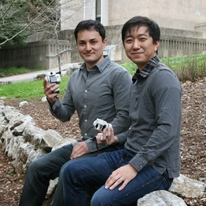 Reflex Robotics cofounders Enes Mentese and Seongdo Kim hold prototypes of their Raven robotic camera system. (Photo by T. Stephens)