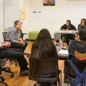 Napolitano talks with girls in the Youth Empowerment Institute with professor Chris Benner, executive director of the Everett Program.