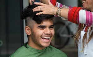 A smiling shavee takes part in the Genomics Institute head-shaving event.