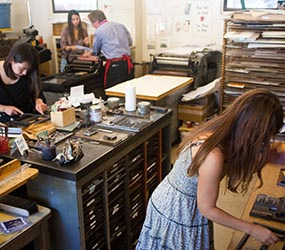 Students working on projects in the Cowell Press class. Photo by Alison Tassio.