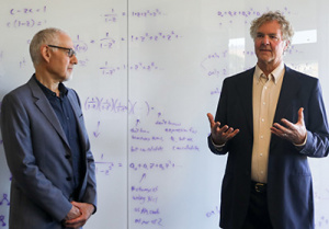Alexander Wolf, dean of the Baskin School of Engineering (left), with David Haussler at the new headquarters of the Genomics Institute at 2300 Delaware Ave. (Photo by C. Lagattuta)