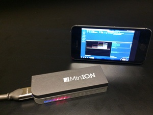 "The MinION™ DNA sequencer from Oxford Nanopore Technologies is a pocket-sized, portable DNA sequencer based on nanopore sequencing technology pioneered at UC Santa Cruz. It generates ""long reads,"" much longer contiguous sequences of DNA code than other sequencing technologies can produce. (Photo by Miten Jain)"