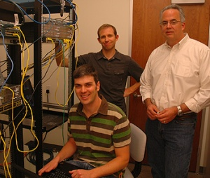 Graduate students Matt Rollins and Zeb Nevins and assistant adjunct professor of computer engineering Brad Smith in the NMO Lab. Photo by T. Stephens.