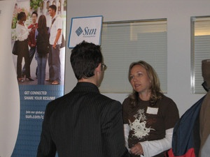 A Sun Microsystems Recruiter Speaks with a Student at a Baskin Career Event