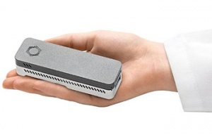 The MinION™ DNA sequencer from Oxford Nanopore Technologies fits in the palm of a hand. (Photo credit: Oxford Nanopore Technologies)