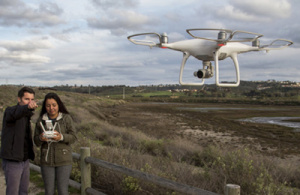 A growing number of researchers are using drones to acquire aerial images of ecosystems, and AI algorithms to analyze those images. Graduate student Ross Davison is using this approach in his research on coastal wetlands. (Photo courtesy of Ross Davison)