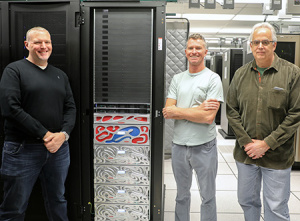 Astrophysicist Brant Robertson (left) and team members Nicholas Brummell (Applied Mathematics) and Brad Smith (Computer Science and Engineering) with the new lux supercomputer recently installed in the UCSC Data Center. (Photos by C. Lagattuta)