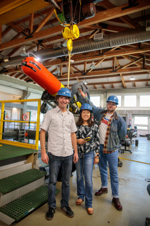 (L to R) MBARI Engineering Brian Kieft, Professor Leila Takayama and Kevin Weatherwax with an AUV