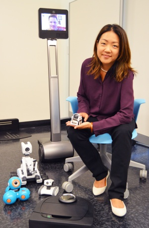 Professor Leila Takayama surrounded by robots